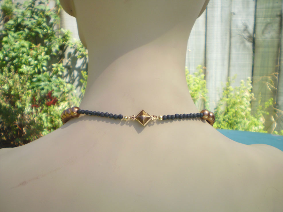 Gold single strand with 4mm black lava beads