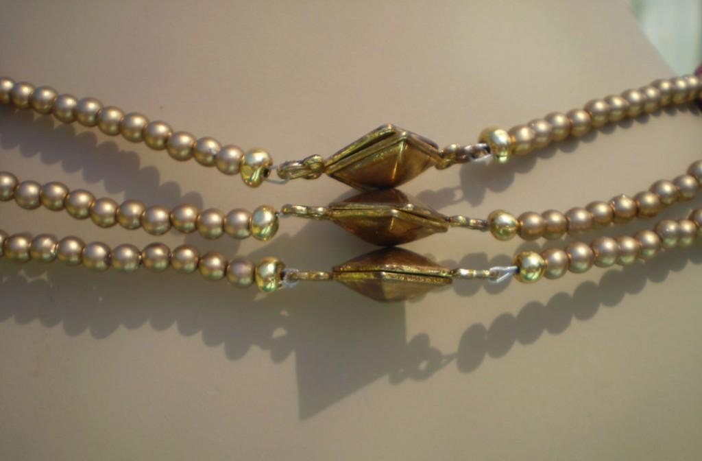 3 strand clasps in back closeup