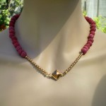Single strand red lava clasp worn center front